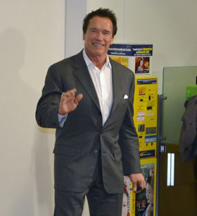 Arnord Schwarzenegger and his grey suit